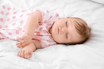 Cute sleeping baby on bed
