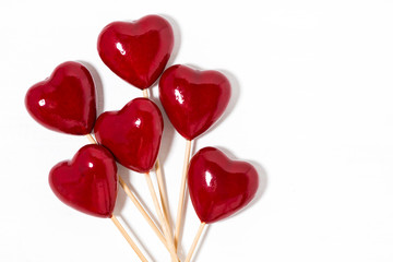 decorative hearts on sticks on a white background
