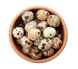 Quail eggs in bowl on white background