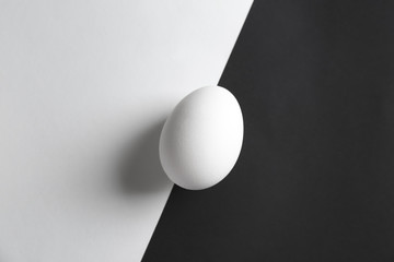 Chicken egg on white and black  background