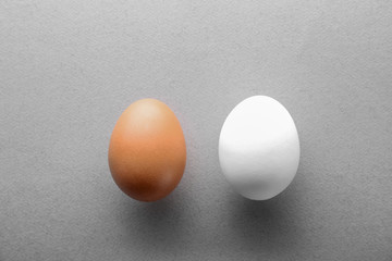 Chicken eggs on color background