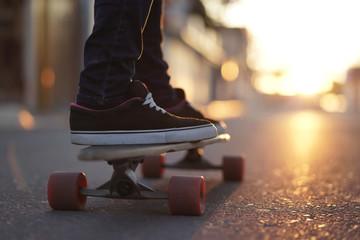 Longboarding in sunset light.
