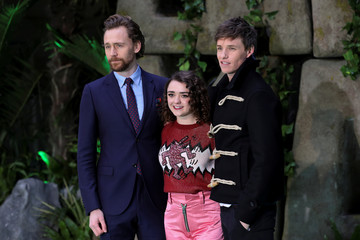 Actors Tom Hiddleston, Maisie Williams and Eddie Redmayne pose for photographs as they arrive at the world premiere of 'Early Man' in central London