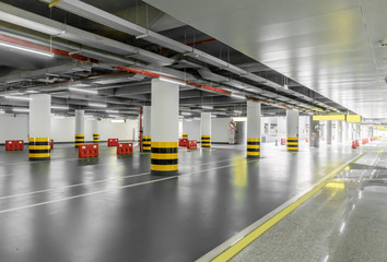 interior of parking garage with car and vacant parking lot in parking building Fototapete