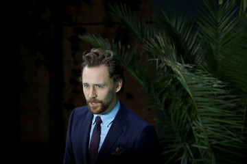 Actor Tom Hiddleston poses for photographs as he arrives at the world premiere of 'Early Man' in central London