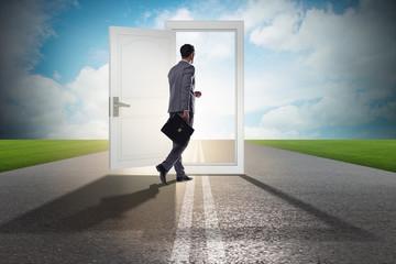 Businessman in front of door in business opportunities concept