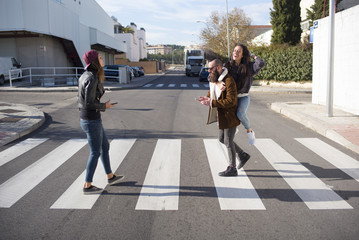 Group of friends at the zebra crossing