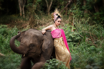 Pretty thai girl in traditional thai costumes with elephant