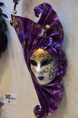 Traditional venetian mask in store on street, Verona Italy.