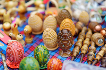 Small wooden toys, Easter eggs and decorations sold on Easter market in Vilnius