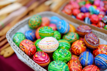 Colorful handmade wooden Easter eggs sold in annual traditional crafts fair in Vilnius