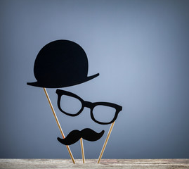 Photo booth props hat, glasses, mustache on grey background
