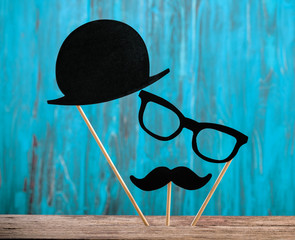 Photo booth props hat, glasses, mustache on turquoise background