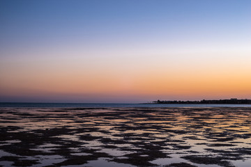 Low tide. Naked coral reef at sunset in the Red Sea