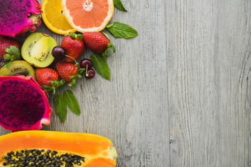 Top view of delicious fruits on wooden surface