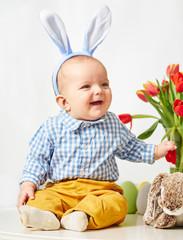 Happy baby boy with bunnies ears