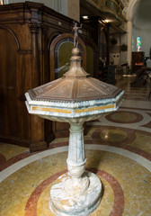 Ancient marble font with copper lid in an old church in Marostica, Italy.