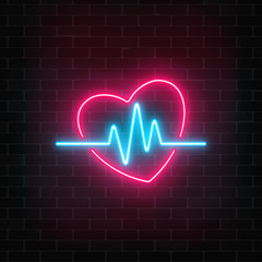 Glowing neon medicine concept sign with cardiogram graph in heart shape on a brick wall background.