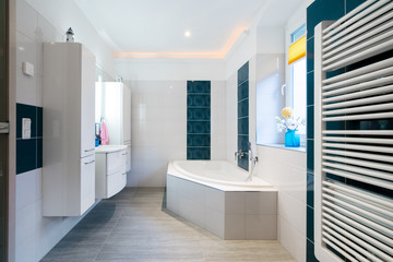 Modern Bathroom - Glossy white and blue tiles - bathtub, sink and floor heating horizontal shot