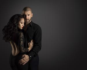 Couple Fashion Portrait, Young Man Embrace Beautiful Woman in Elegant Black Dress