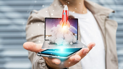 Businessman with rocket launching from a laptop 3D rendering