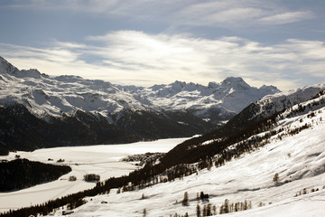 A beautiful view of the snow covered landscape and mountains in the alps switzerland