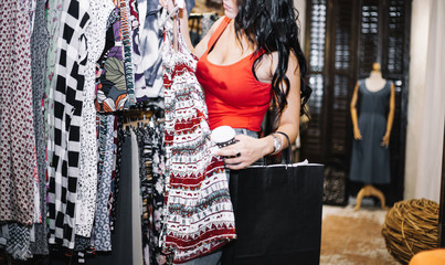 Woman shopping with bag in hand. business style and people concept, coffee cup, with clothes looking
