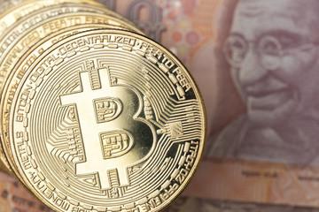 Golden  bitcoin and indian rupee money.