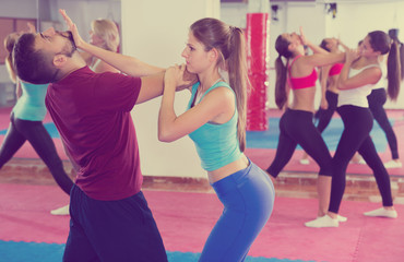 Happy women are doing self-defence-karate moves