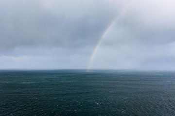 Rainbow near Dunluce Castle  in the atlantic ocean in Ireland