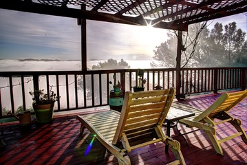Relax Above the Clouds. Panoramic Landscape View From a Large Deck in Clearlake, California.