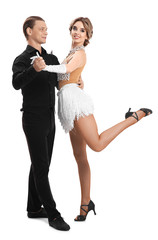 Couple of young dancers on white background