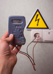 Electrician makes electrical measurements; jumps tension, electrical safety.