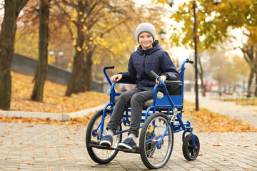 Little boy in wheelchair outdoors