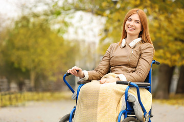 Young woman in wheelchair outdoors