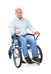 Senior man in wheelchair on white background