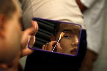 """A participant gets ready backstage before the beauty contest """"Mrs Colombia"""" in Medellin"""