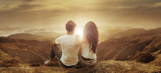 Young, relaxed couple watching a sunset