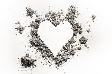 Romantic heart love symbol made in ash, dust or sand