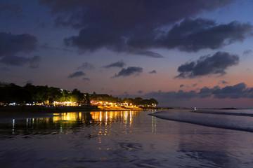Night lights reflection after sunset at Kuta beach, Bali, Indonesia