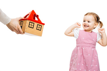 Happy toddler girl receiving a toy house