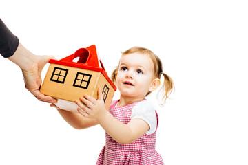 toddler girl receiving a house