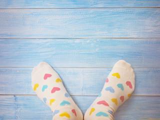 Selfie feet wearing white socks with pastel heart shape pattern