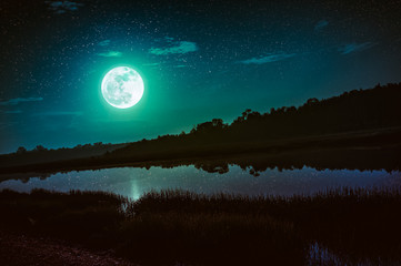 Wall Mural - Night sky with full moon and many stars, serenity nature background.