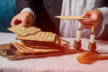 Sabbath kiddush ceremony composition with two candles and traditional passover matzah fresh bread
