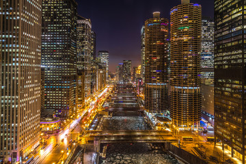 Chicago night skyline river and buildings