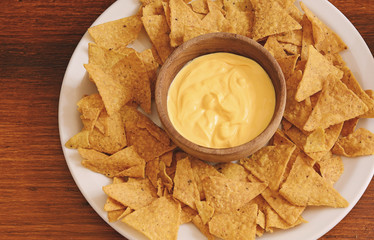 Top view of nachos with cheese dip