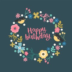 """A cute illustrated greeting card with floral wreath and hand lettering """"happy Birthday""""."""