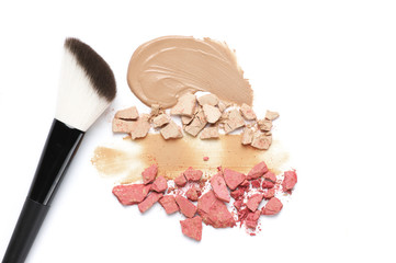 Heap of various crashed makeup products