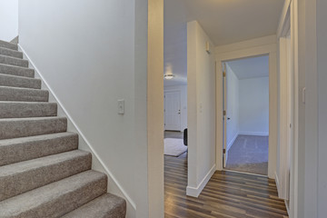 Image of a White hallway with a staircase